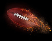 Flying rugby ball with dirt Stock Image