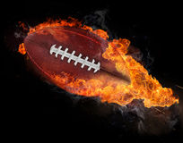 Flying rugby ball with fire flames Stock Images