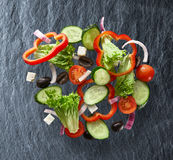 Flying salad on slate background Stock Photos