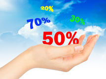 Flying Sale numbers on hand Stock Images