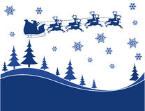 Flying Santa and Christmas Reindeer Stock Images