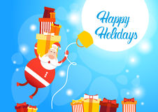 Flying Santa Claus Hold Big Present Box Merry Christmas Greeting Card Happy New Year Royalty Free Stock Photography