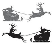 Flying Santa Claus in a reindeer sleigh Stock Images