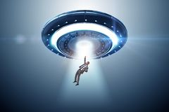 The flying saucer abducting young businessman stock photos