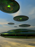 Flying Saucer Fleet. A fleet of flying saucer fly overhead, the beginning of an invasion Royalty Free Stock Image