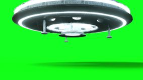 Flying saucer isolate on green screen. UFO. Realistic shaders and motion blur. 4K animation. Flying saucer isolate on green screen. UFO. Realistic shaders and stock footage