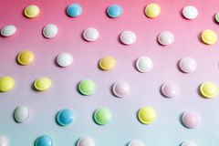 Flying saucer multi coloured candy. Sweets on a gradient background pink and blue Royalty Free Stock Image