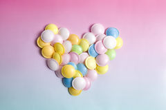 Flying saucer multi coloured candy. Sweets on a gradient background pink and blue Royalty Free Stock Photography