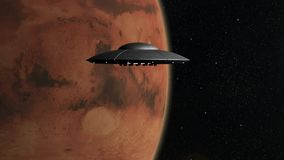 Flying Saucers. 3d render of flying saucers over stars background and Mars planet stock footage