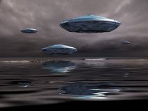UFOs. Flying saucers over the ocean. 3D rendering Stock Images