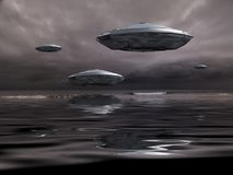 UFOs. Flying saucers over the ocean. 3D rendering Royalty Free Stock Images