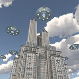 Flying saucers over a skyscraper Stock Photography