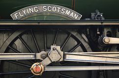 Flying Scotsman. Close up of name plate rods cranks and wheels royalty free stock image