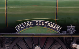 The Flying Scotsman Nameplate. The Flying Scotsman is a preserved steam locomotive and is pictured in Carlisle Citadel station in Cumbria stock photo