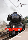 The Flying Scotsman. A preserved steam locomotive, heads The Waverley as it departs Carlisle Citadel station in Cumbria stock photography
