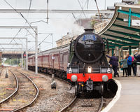 The Flying Scotsman. A preserved steam locomotive, heads The Waverley in Carlisle Citadel station in Cumbria royalty free stock image