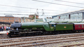 The Flying Scotsman. A preserved steam locomotive, is pictured in Carlisle station. The Scotsman was the first locomotive in UK to reach 100mph royalty free stock photography