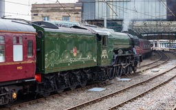 The Flying Scotsman. A preserved steam locomotive, is seen in Carlisle Citadel station in Cumbria stock photography