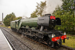 The Flying Scotsman at Ramsbottom Station. The Flying Scotsman porting around its carriages royalty free stock photo