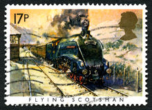 Flying Scotsman UK Postage Stamp. GREAT BRITAIN - CIRCA 1985: A used postage stamp from the UK, depicting an illustration of the famous Flying Scotsman steam royalty free stock photo