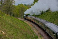Flying Scotsman vintage steam train. The Flying Scotsman steam train travels through the Sussex countryside in the UK on the Bluebell Line carrying steam stock photo