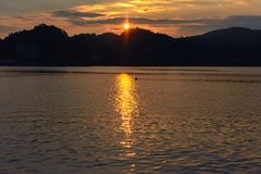 Flying seagull sunset over the mountains in the background royalty free stock photos