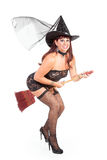 Flying sexy witch riding a broom Royalty Free Stock Photo