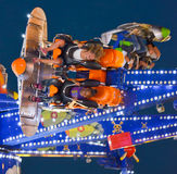 Flying Sideways. Excited teens are flung through the air on an amusement park ride at the 2014 Wisconsin State Fair Stock Photos