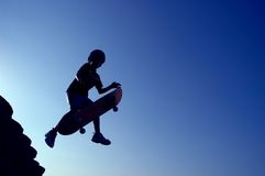 Flying Skateboard. Boy jumping with skateboard Stock Image