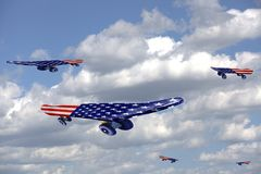 Flying Skateboards with USA flag on a blue sky and clouds royalty free stock photos