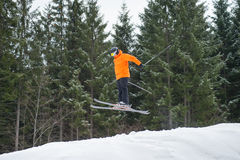 Flying skier man at jump from the slope of mountains Stock Photography