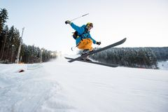Flying skier man at jump from the slope of mountains Royalty Free Stock Photo