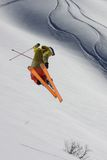 Flying skier on mountains Royalty Free Stock Photo