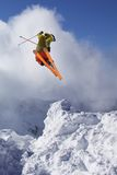 Flying skier on mountains Stock Images