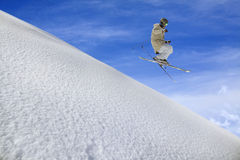 Flying skier on mountains Royalty Free Stock Image
