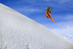 Flying skier on mountains Stock Photo