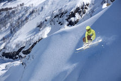 Flying skier on mountains, extreme sport Royalty Free Stock Photography