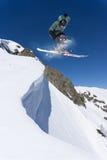Flying skier on mountains, extreme sport Royalty Free Stock Photos