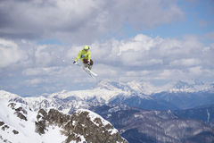 Flying skier on mountains, extreme sport Royalty Free Stock Images