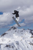 Flying skier on mountains, extreme sport Stock Image