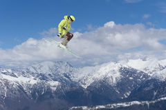 Flying skier on mountains, extreme sport Stock Images