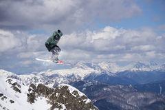 Flying skier on mountains, extreme sport Stock Photos