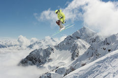 Flying skier on mountains. Extreme sport Stock Photography