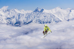 Flying skier on mountains. Extreme sport Stock Photos