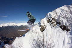 Flying skier on mountains. Extreme sport Royalty Free Stock Image