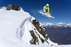 Flying skier on mountains. Extreme sport Royalty Free Stock Images