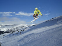 Flying skier on mountains. Extreme sport Stock Images