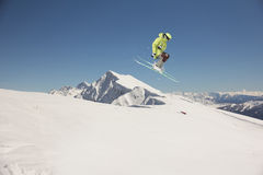 Flying skier on mountains. Extreme sport Royalty Free Stock Photography