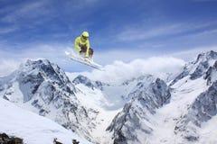 Flying skier on mountains. Extreme sport. Stock Photo