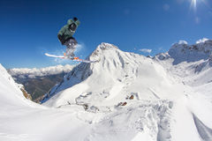 Flying skier on mountains. Extreme sport. Royalty Free Stock Images